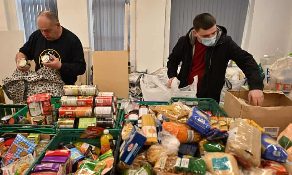 Volunteers at a soup kitchen in Blackpool make food parcels.