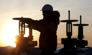 An oil worker checks the pipeline at an oilfield outside the western Siberian city of Kogalym.