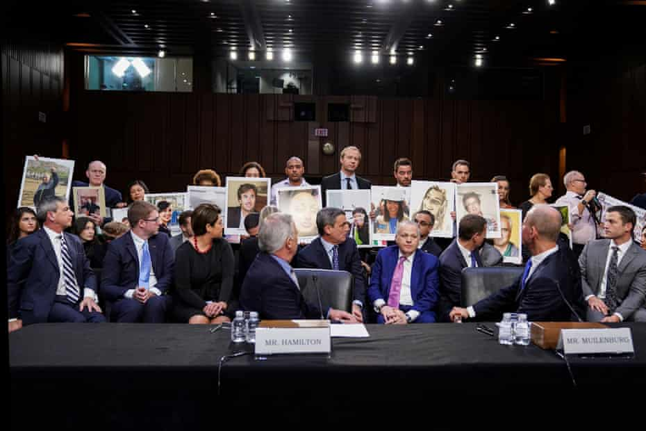Family members of those who died in the twin 737 Max crashes hold pictures of the victims as a congressional hearing in Washintgon in October 2019.