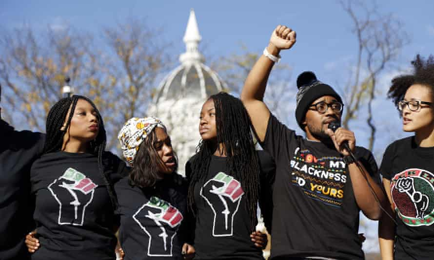 Concerned Student 1950, led by University of Missouri graduate student Jonathan Butler, second from right, speaks following the announcement that University of Missouri System President Tim Wolfe would resign Monday.