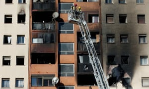 Firefighters tackle the blaze at the Badalona apartment block.