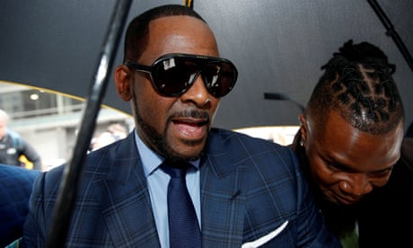 R Kelly: tape 'showing sexual abuse' handed to police
