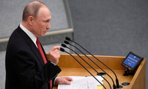Vladimir Putin addresses MPs in Russia's lower house of parliament on Tuesday.