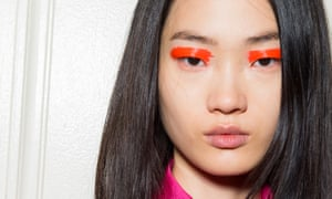 Lipstick on the lids: try a swipe of brightness to get this blocky look as seen at Carolina Herrera.
