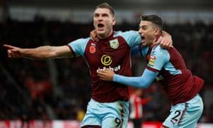 Burnley's Sam Vokes celebrates scoring their goal against Southampton with Matthew Lowton.