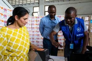 World Food Programme staff in Mogadishu demonstrate a biometric food aid ID system to Priti Patel.
