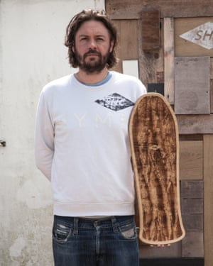 Handmade: David Germaine with one of his bespoke hand planes, part of his surfboard range.