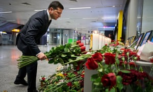 Ukrainian President Volodymyr Zelenskiy lays flowers to commemorate victims of the Ukraine International Airlines Boeing 737-800 plane crash, at a memorial in Boryspil International airport outside Kiev, Ukraine January 9, 2020.