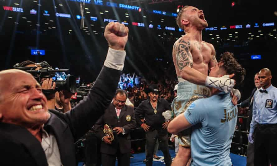 Carl Frampton celebrating with his former trainer Shane McGiugan after his victory against Léo Santa Cruz in July 2016.