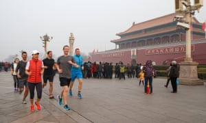 Facebook's CEO, Mark Zuckerberg, and friends jog past Tiananmen Gate in Beijing.
