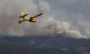 A firefighter plane heading to the fire