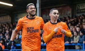 Miguel Almirón celebrates his goal with Newcastle teammate Joelinton.