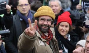 Cédric Herrou gestures as he leaves court.
