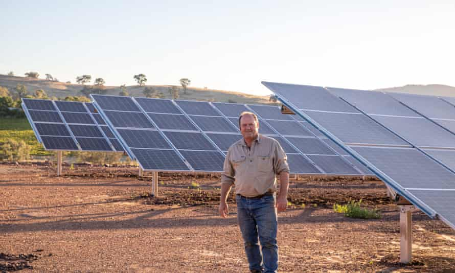 David Ritchie in front of his solar panel array at his winery in Mansfield, Victoria.