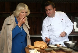 The Duchess of Cornwall tastes honey flavoured with black truffles at French Black Truffles of Canberra on the city's eastern edge.