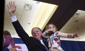 Doug Jones waves to supporters after the results were announced.