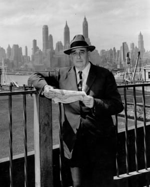 Robert Moses stands in front of Manhattan skyline in 1956.