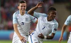 Demarai Gray, right, celebrates opening the scoring for England Under-21s against Poland Under-21s.