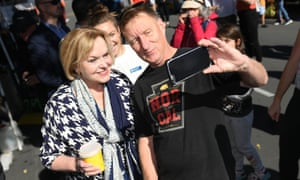 Collins poses for a selfie with a voter in Napier.