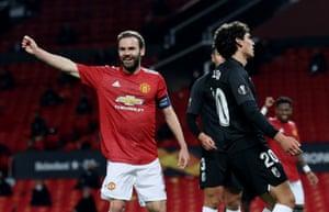 Juan Mata celebrates the own goal by Granada's Jesus Vallejo.