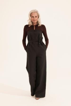 black long sleeved jumpsuit, grey sandals