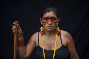 """Sandra Tembe, 46, poses for a portrait during a meeting of the Tembe tribes in the Tekohaw village, in the Alto Rio Guama Indigenous Reserve, in Brazil's Para state. """"The body paintings are a symbol of out link to nature,"""" said Sandra, the director of the school at Tekohaw village, where the walls are adorned with paintings of indigenous maracas and Amazonian animals like piranhas and snakes."""