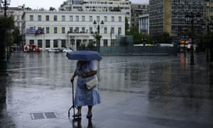 An elderly woman alone in Athens.