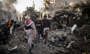 The aftermath of a car bomb attack in eastern Mosul.