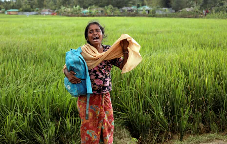 Taslima, 20, a Rohingya refugee who escaped Myanmar, cries because her father died while crossing the border, in Palang Khali, Bangladesh, on 16 October