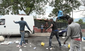 Asylum seekers from Ivory Coast protest against conditions in their refugee shelter in Naples.