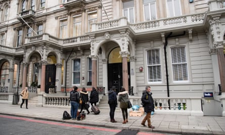 Journalists outside the London HQ of Orbis Business Intelligence.