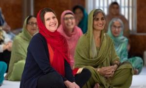 Jo Swinson (left) during a visit to the Gurdwara Singh Sabha Temple in Glasgow.