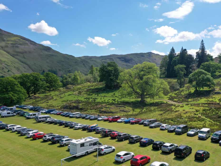An overflow car park in a field in Glenridding.