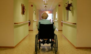 An elderly person in a wheelchair in a retirement home