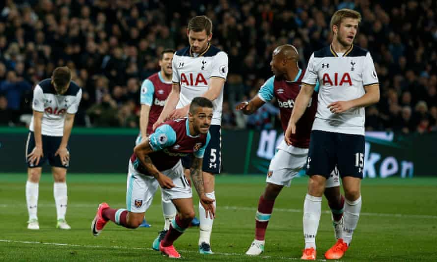 Manuel Lanzini turns away in celebration after scoring the game's only goal, as Tottenham players look dejected.