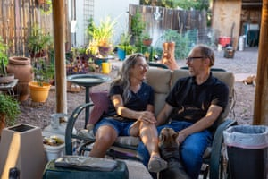 Ann, 66, and Bill Whitmire, 56, at their home in Phoenix, Arizona on Oct. 13, 2020. They each fell ill and recovered from COVID-19 earlier this year in July and January.