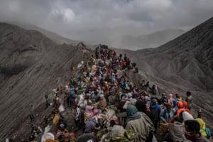 Tenggerese gather at the crater of Mount Bromo during the Yadnya Kasada festival in Probolinggo, Indonesia.