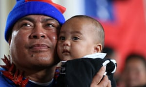 Iose Amosa and his son Amosa, five months old, join fans at Otahuhu Rugby Club to watch the international Test match played in Apia between the All Blacks and Samoa.