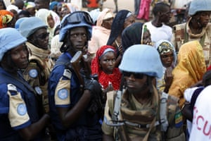 UN soldiers stand near Muslim faithful queuing to enter the central mosque in Bangui, Central African Republic