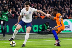 Harry Maguire of England shields the ball from Quincy Promes of Holland