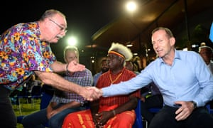 Tony Abbott shakes hands with Liberal MP Warren Entsch during a community ceremonial dinner on Thursday Island in the Torres Strait. Entsch supports gay marriage.
