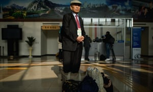 """An elderly South Korean man travels to the event. About 100 divided families have been given the chance to attend the once-in-a-lifetime meeting with relatives they lost following the <a href=""""http://www.theguardian.com/books/shortcuts/2013/jul/24/korean-war-british-memories-forgotten-conflict"""">1950-1953 Korean war</a> and the division of the Korean peninsula"""