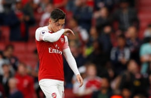 Ozil, dejected after the final whistle.