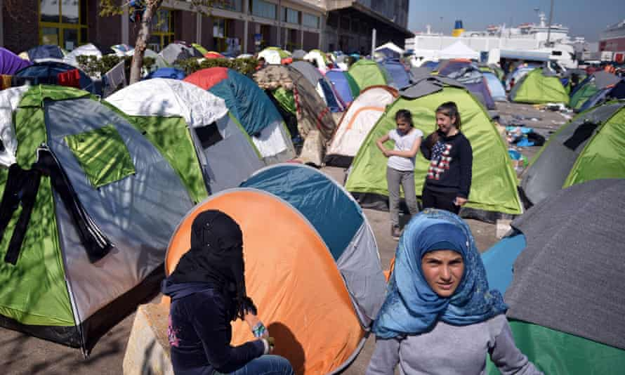 Refugees at a makeshift camp at the port of Piraeus, Athens, on 31 March.