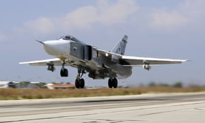 A Russian SU-24M jet fighter takes off from Hmeimim airbase in Syria on Saturday.