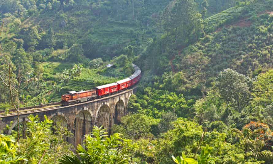 Passenger train crossing the nine arches viaduct near Ella, Sri Lanka.