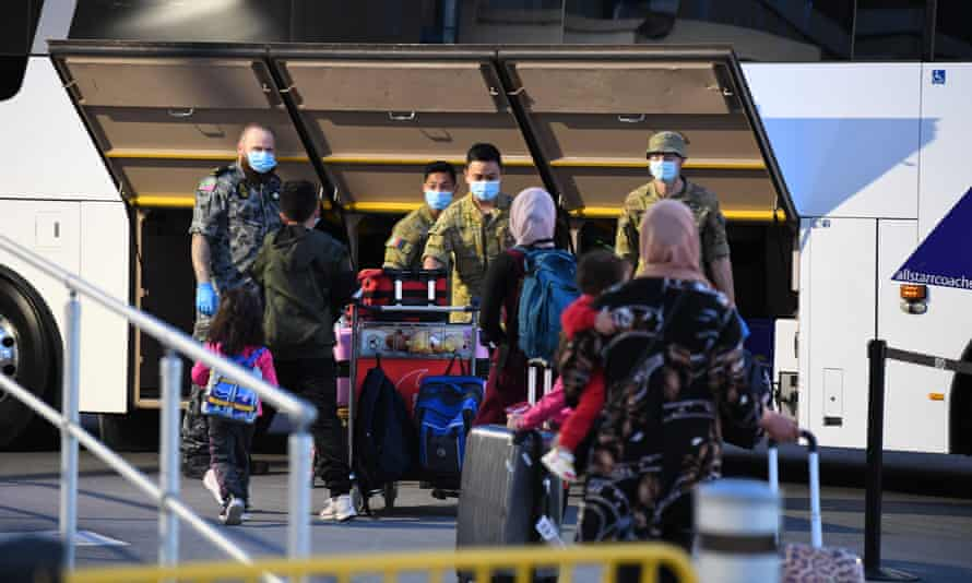 Passengers arrive at Sydney International Airport off a Qatar Airways flight