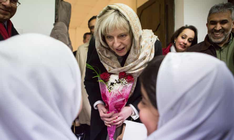 Theresa May visits Al Madina mosque in east London as home secretary in 2015.