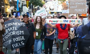 Protesters march down a Brisbane CBD street