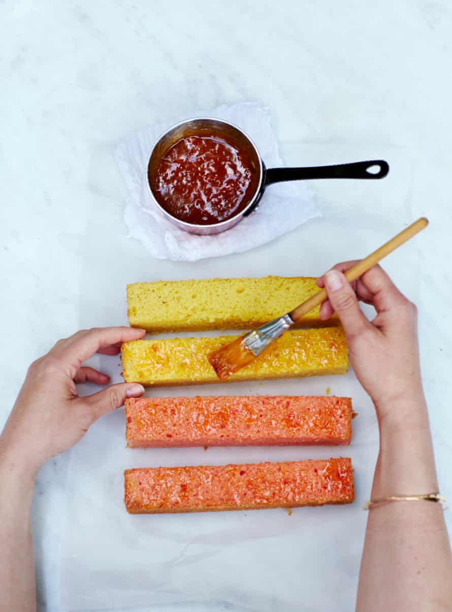Remove the cake pieces from the oven and allow them to cool in the tin(s).Heat the apricot jam in a small pan. Brush all the long sides of the cake pieces with jam...